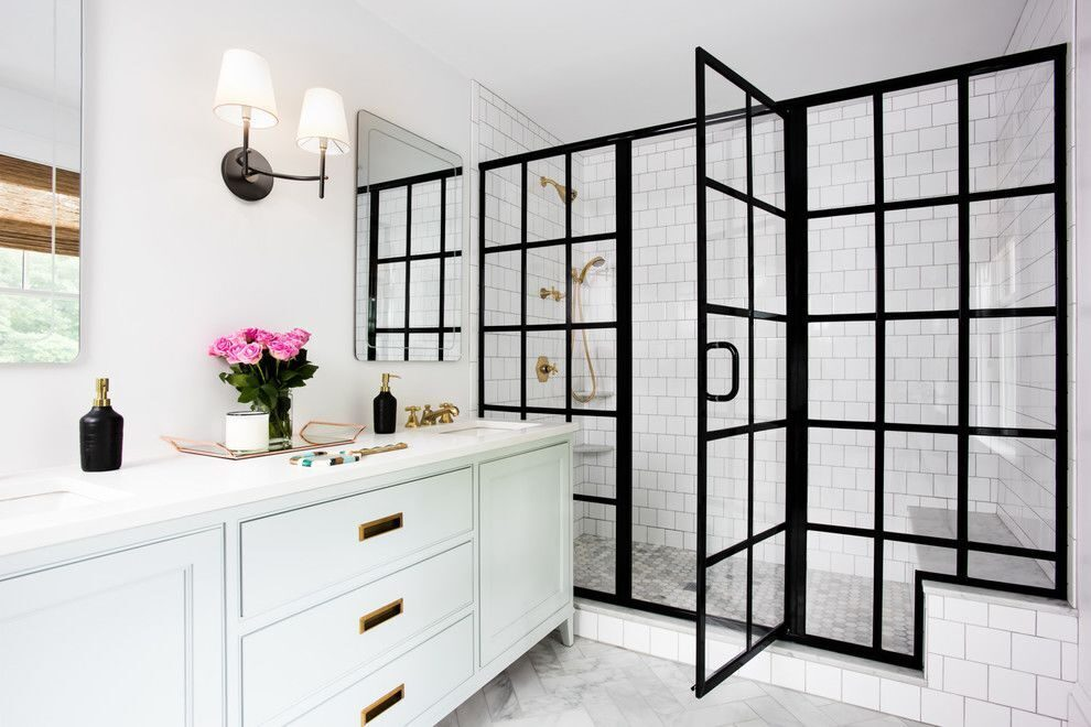 Large-walk-in-shower-with-black-frame-door